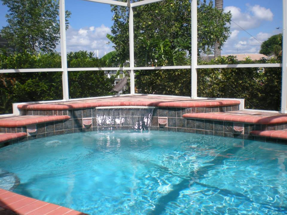 Custom pool designs features port charlotte popa for Custom pool designs